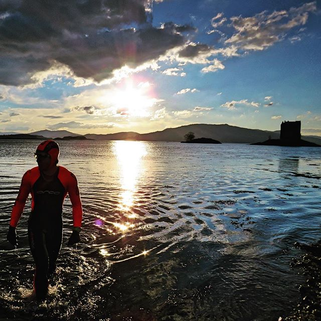 Max Swimming at Castle Stalker, Scotland.