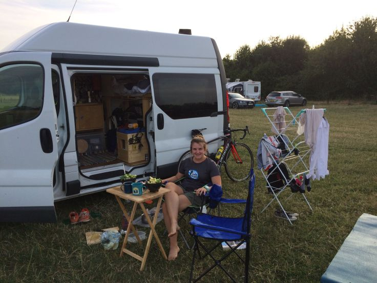 Stacey at the campsite living in their self-built campervan in summer 2018.