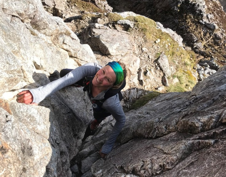 Keri soloing Curved Ridge, an easy rock climb which features on the Glencoe Skyline race route.