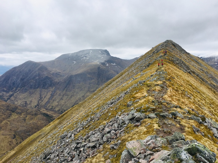 A Girls on Hills guided recce of the a Ring of Steall skyrace route (with Ben Nevis, the highest mountain in the UK, in the background).